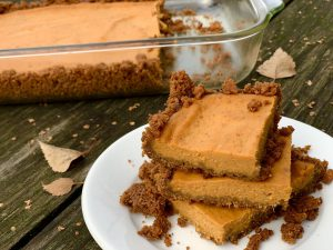 A stack of pumpkin pie bars on a plate