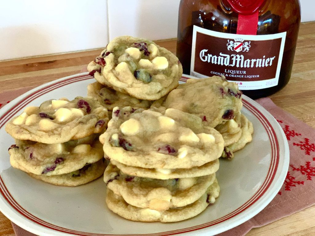 plate of cookies with a liquor bottle
